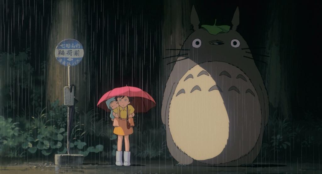 A cena em que Satsuki encontra Totoro na chuva é uma das mais famosas do cinema japonês (Foto: Reprodução)
